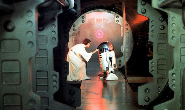 Leia slipping the Death Star plans to R2D2